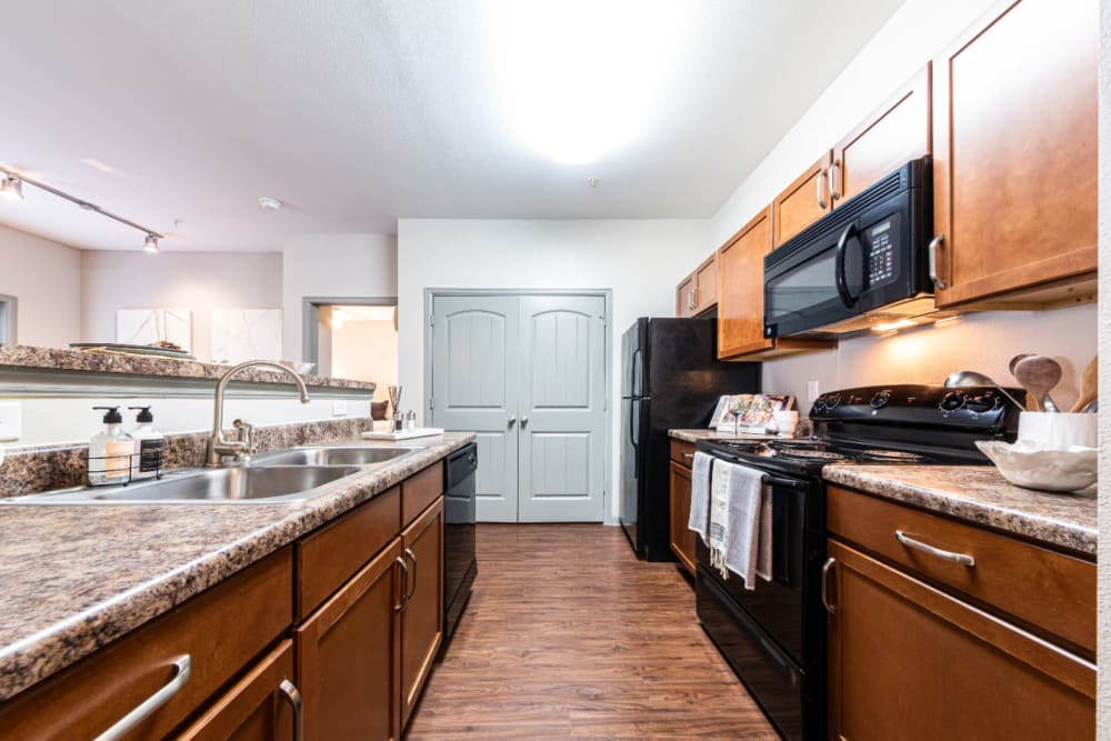 Kitchen with granite counters at Marquis at Katy in Katy, Texas