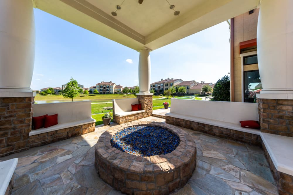Semi private fire pit area with sitting benches surrounding at Marquis at the Reserve in Katy, Texas