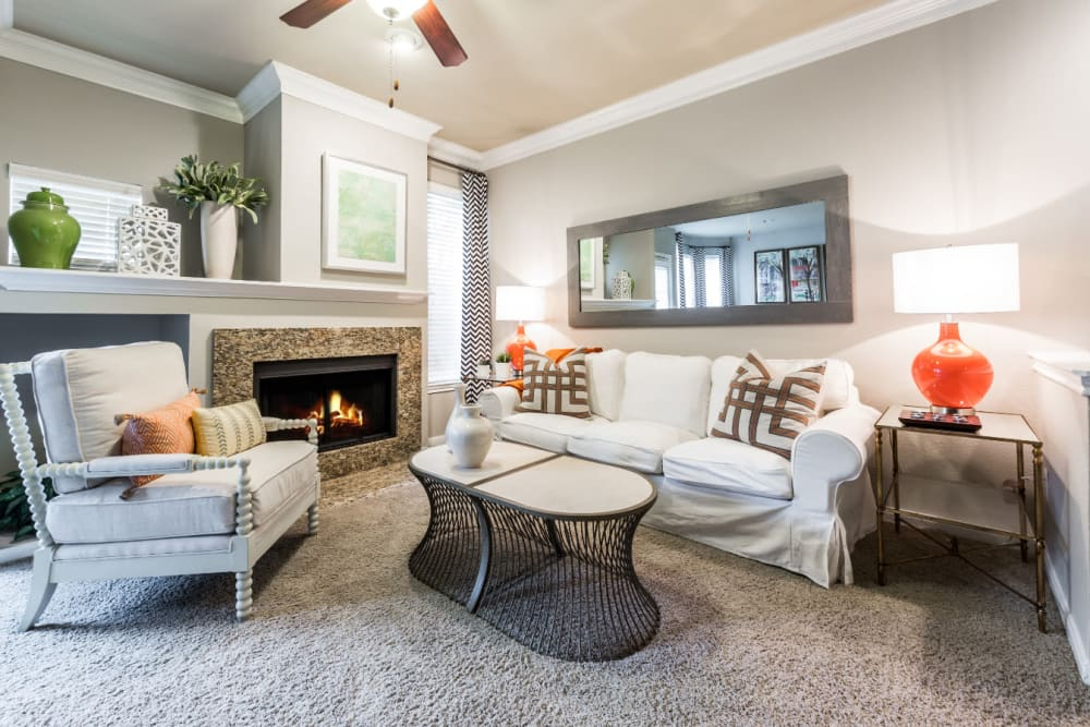 Spacious living room with fireplace and carpet at Marquis at Stonegate in Fort Worth, Texas