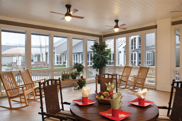 Dining area and covered porch at Avenir Memory Care at Fayetteville in Fayetteville, Arkansas.