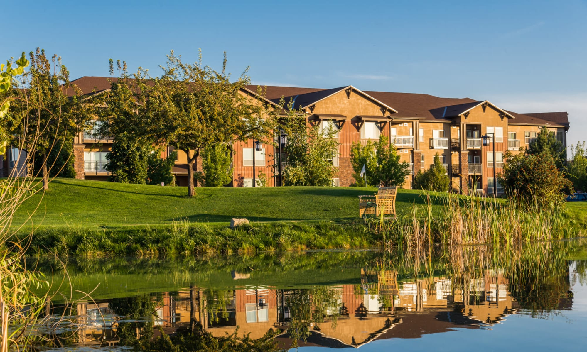 The building exterior and pond at Touchmark at Meadow Lake Village in Meridian, Idaho