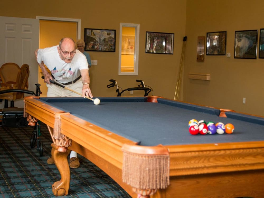 Resident playing billiards at Governor's Port in Mentor, Ohio