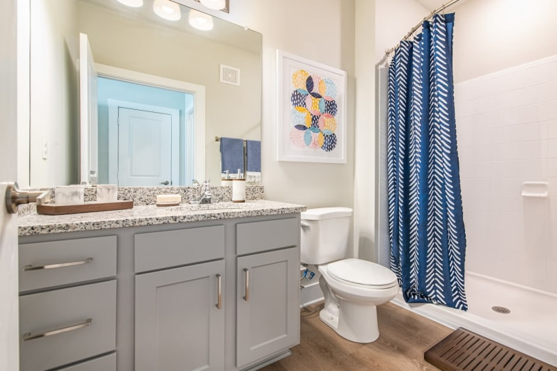 Roomy bathroom with lots of storage space under the large vanity at The Mason in Ladson, South Carolina