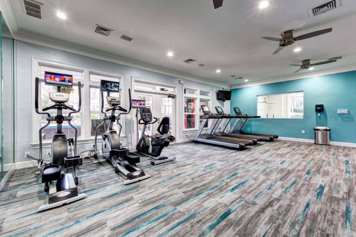 Treadmills and elliptical machines with view of outdoor pool at Marquis on Cary Parkway in Morrisville, North Carolina