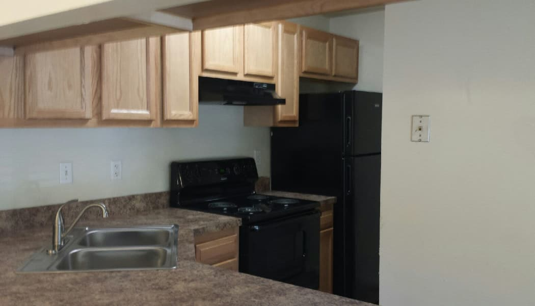 Kitchen at Woodbriar Apartments in Chesapeake, Virginia