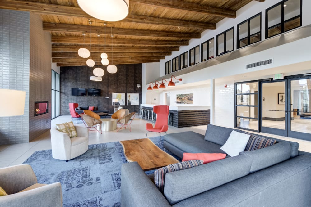Oversized clubhouse with ample seating area for entertaining at Ashford Belmar in Lakewood, Colorado