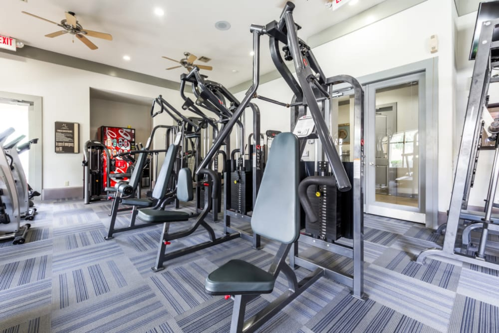 Weight machines in fitness room at Marquis at Clear Lake in Webster, Texas