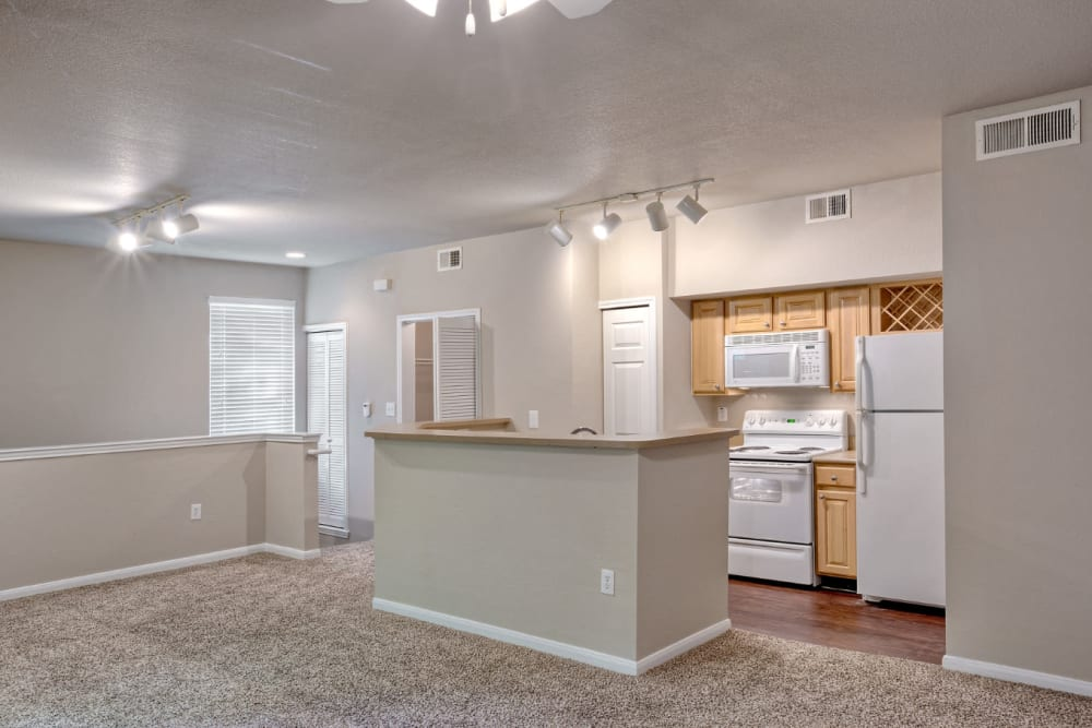 Kitchen with wood style flooring at Marquis Bandera in San Antonio, Texas