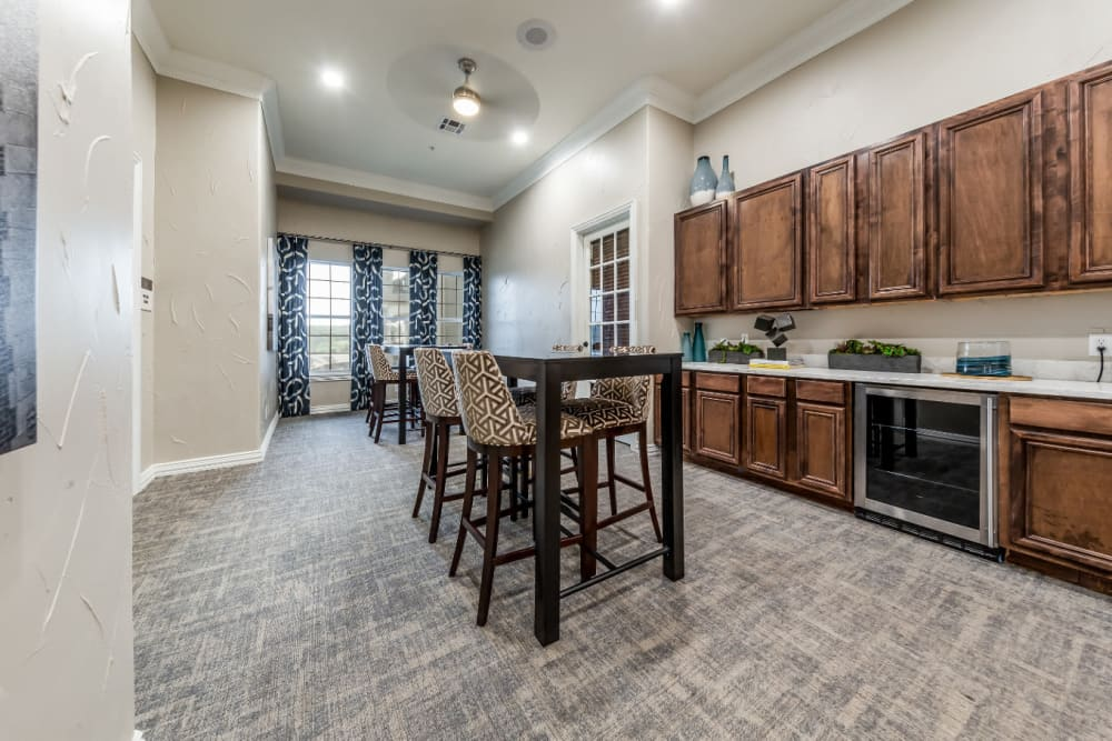 Community kitchen and dining area at Marquis at Stone Oak in San Antonio, Texas