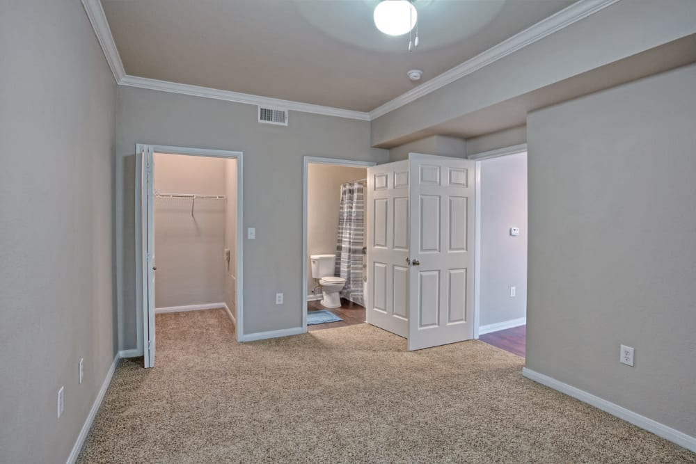 Bedroom with walk-in closet and private bathroom at Marquis Bandera in San Antonio, Texas