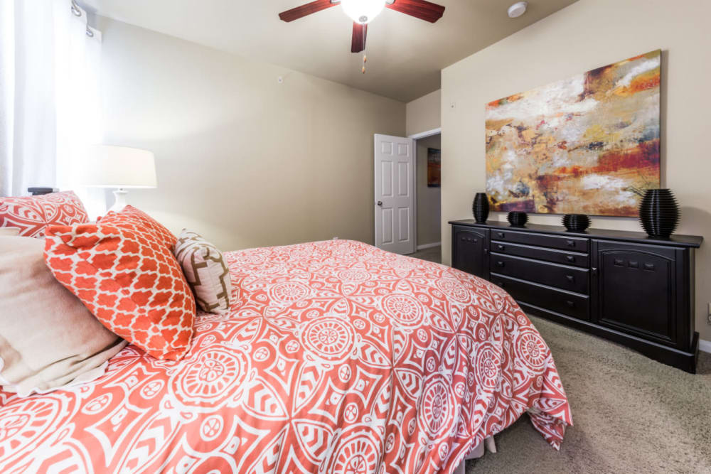 Spacious bedroom with carpet and ceiling fan at Marquis at Stonegate in Fort Worth, Texas