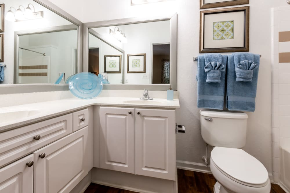 Bright bathroom with large mirrors and double sink at Marquis at Sugarloaf in Duluth, Georgia
