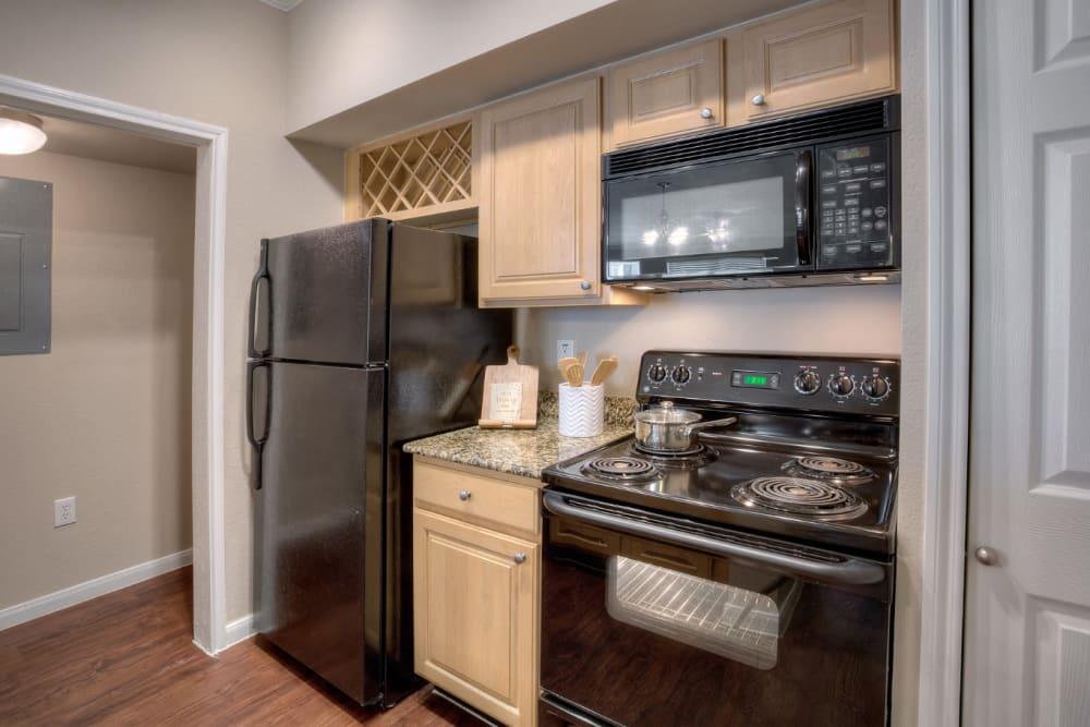 Kitchen with granite counters at Marquis Bandera in San Antonio, Texas
