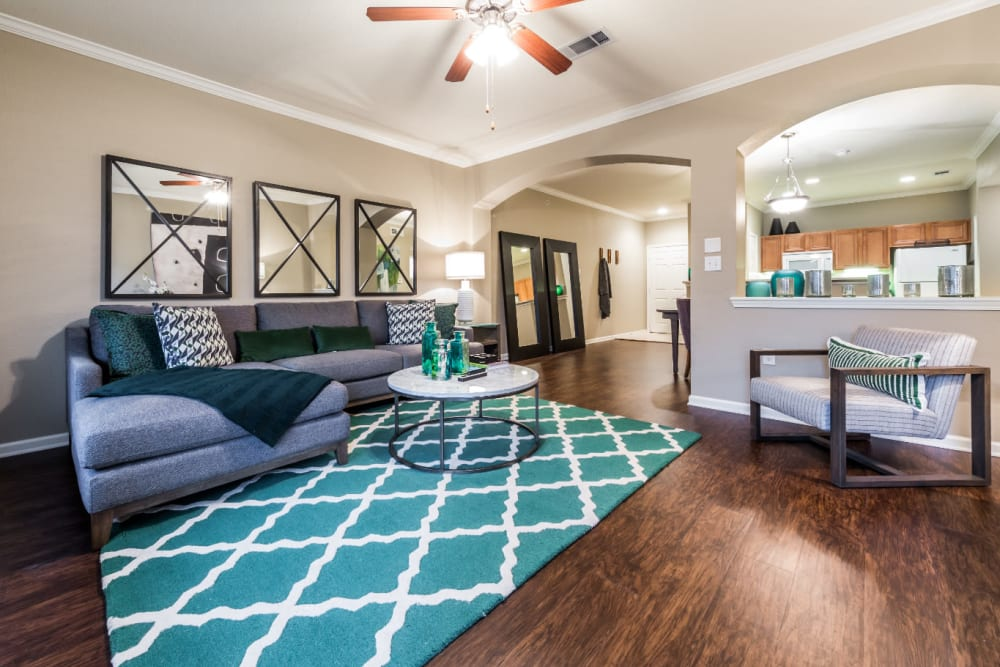 Bright and colorful living area with wood flooring at Marquis at The Cascades in Tyler, Texas