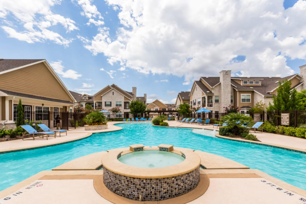 Hot tub and resort-style, sparkling swimming pool at Marquis at Cinco Ranch in Katy, Texas