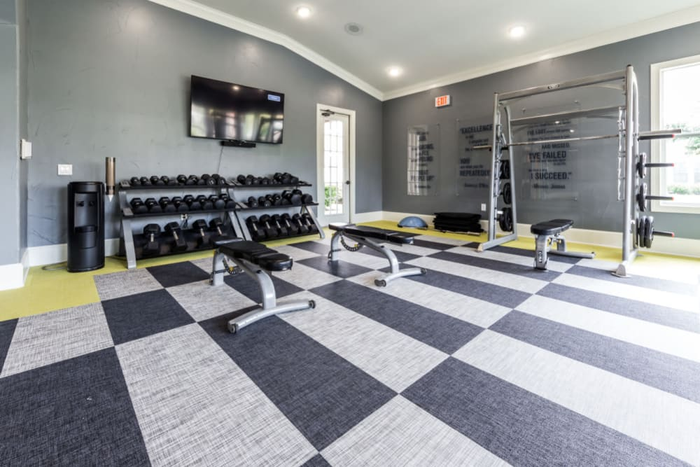 Free weight section of fitness room at Marquis at The Cascades in Tyler, Texas