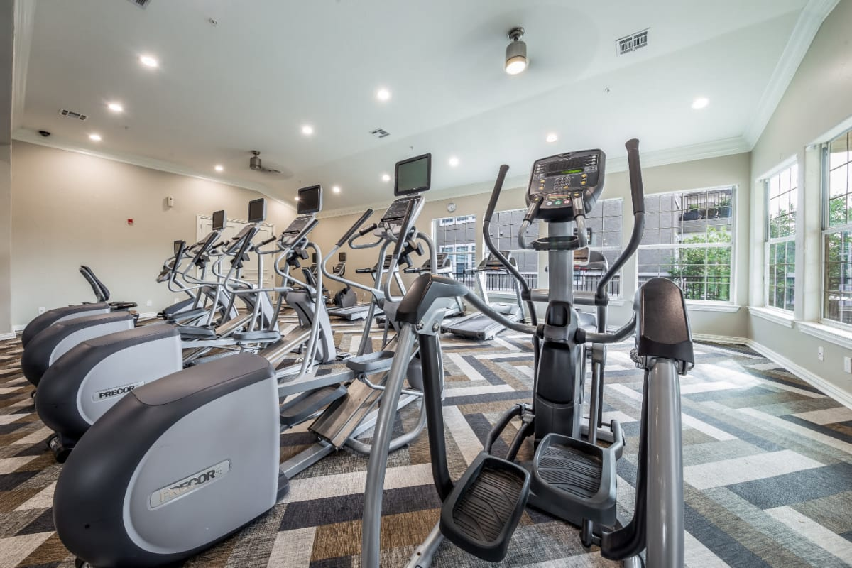 Cardio machines with private monitors at Marquis at Stone Oak in San Antonio, Texas