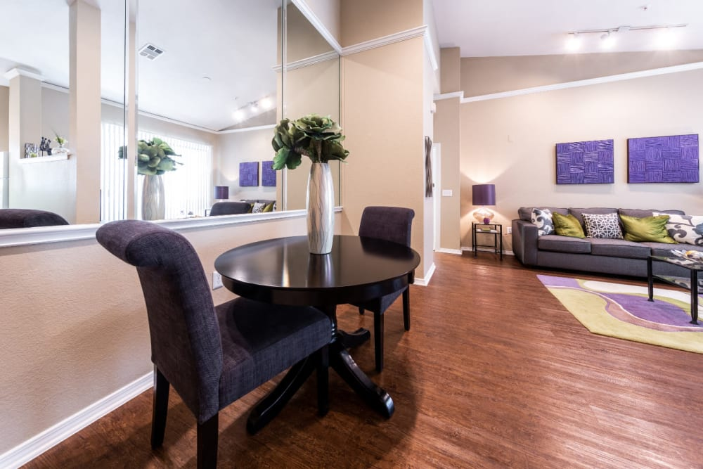 Dining area of open living space at Marquis at Waterview in Richardson, Texas