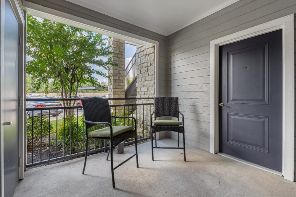 Roomy private balcony with sitting chairs at Marquis at Sugar Land in Sugar Land, Texas