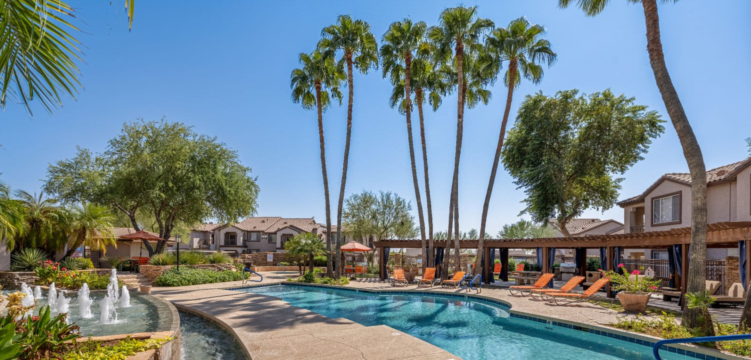 Sparkling pool surrounded by trees at Azure Creek in Cave Creek, Arizona