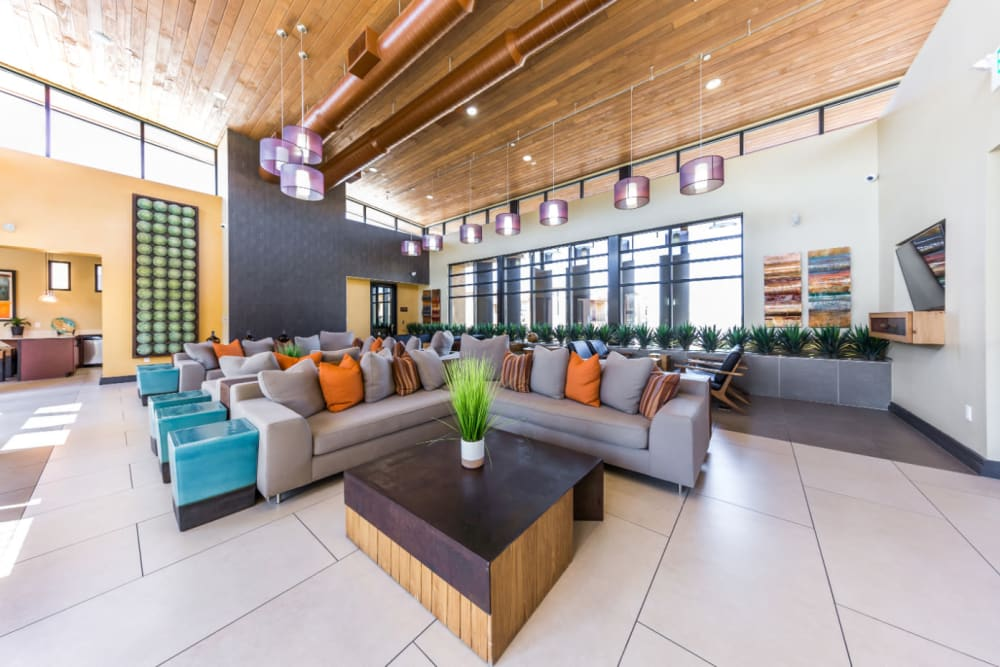 Community clubhouse with several sitting couches at Marquis at Desert Ridge in Phoenix, Arizona