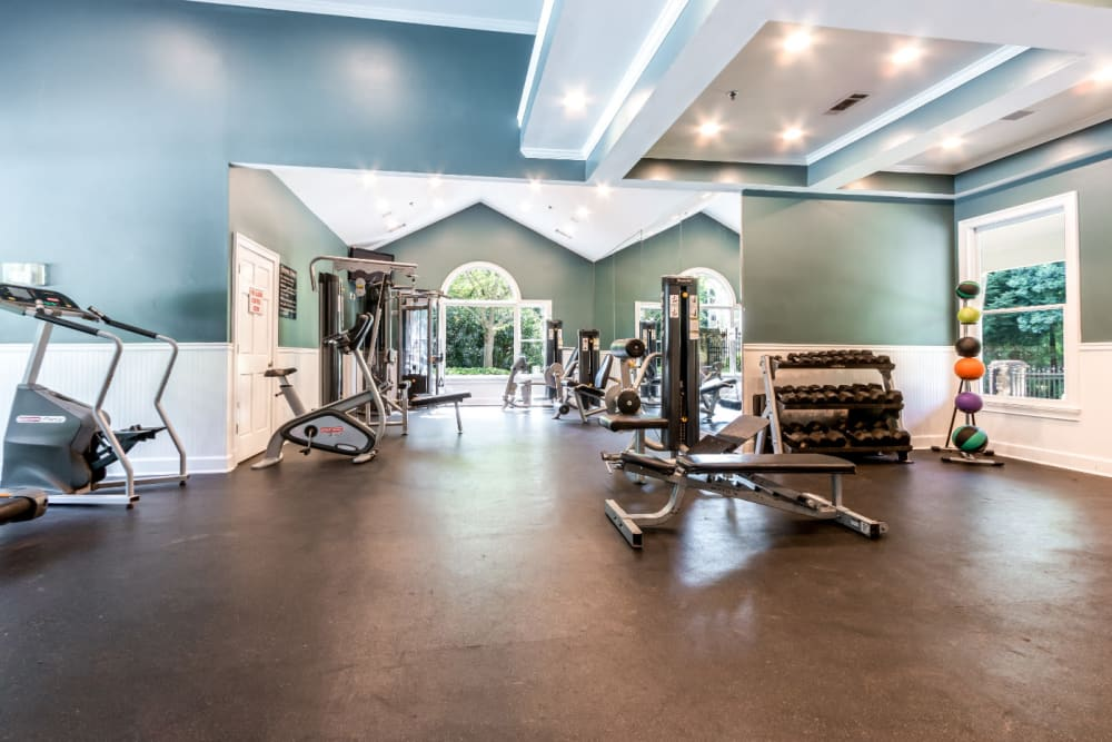 Cardio machines and weight machines in spacious fitness room at Marquis at Sugarloaf in Duluth, Georgia
