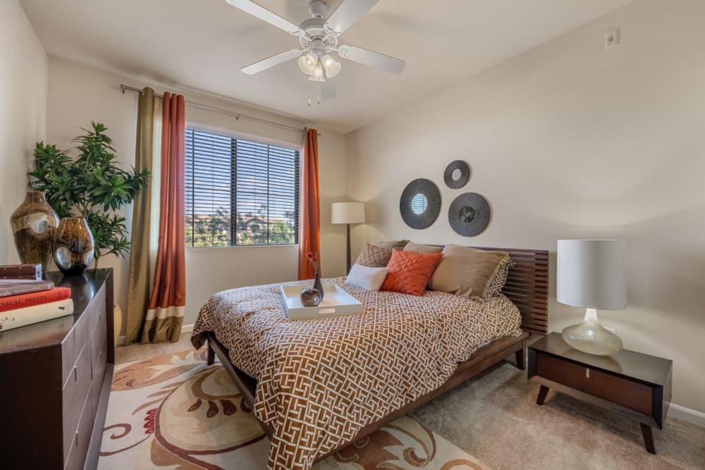 Desert tone style bedroom with large window at Marquis at Sonoran Preserve in Phoenix, Arizona