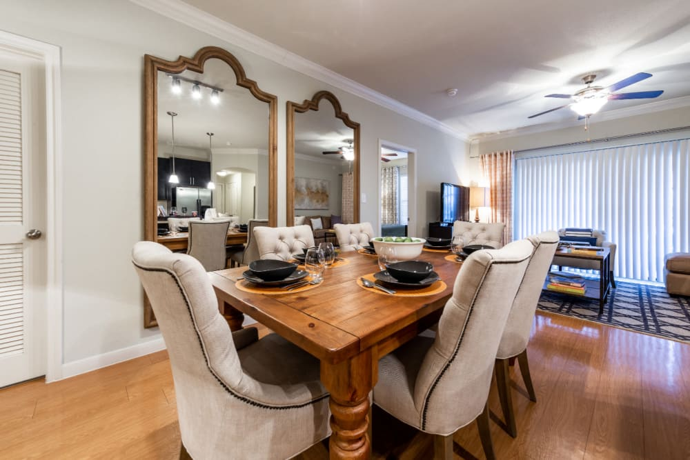Large dining room with table for six at Marquis at the Reserve in Katy, Texas