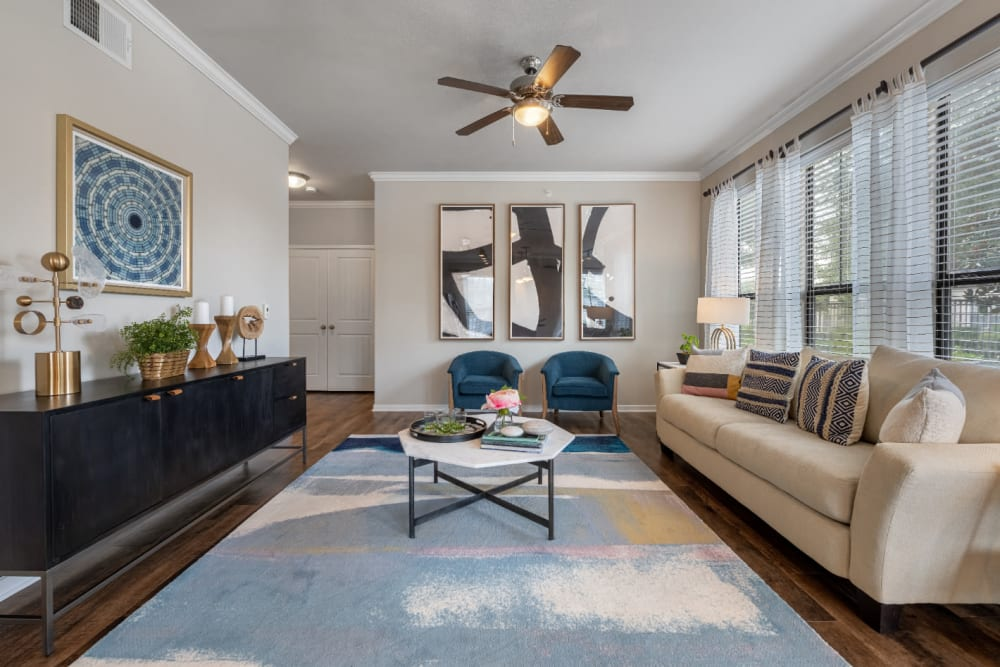Spacious and bright living area with large windows at Marquis at Sugar Land in Sugar Land, Texas