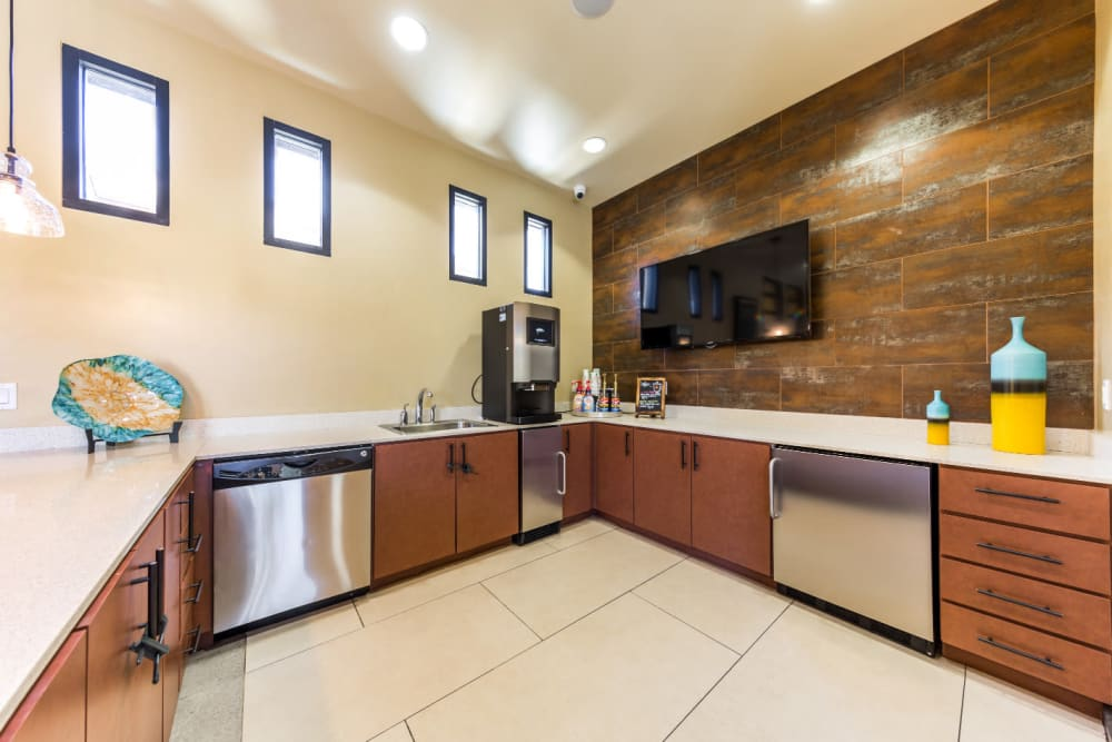 Community clubhouse kitchen area with large monitor screen at Marquis at Desert Ridge in Phoenix, Arizona