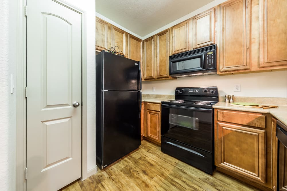 Bright kitchen with modern appliances and separate pantry at Marquis at Clear Lake in Webster, Texas