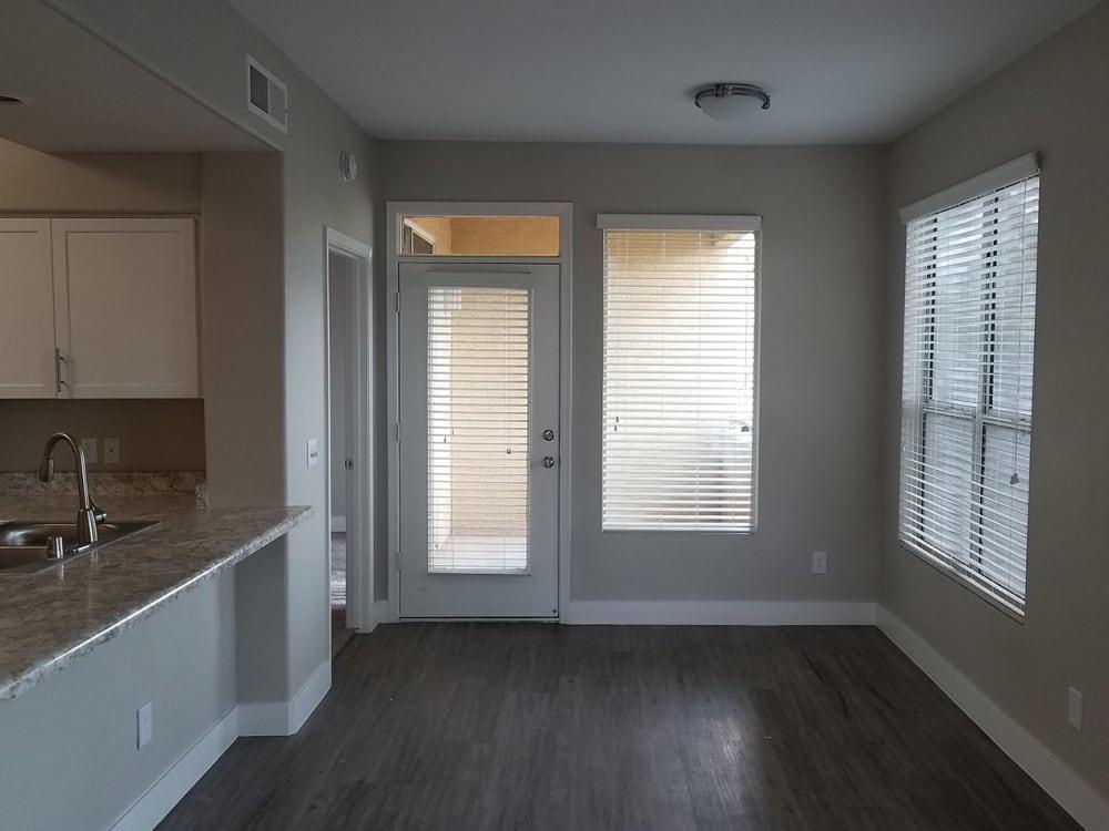 Dining room showcasing hardwood floors in model home at The Retreat Apartments in Phoenix, Arizona