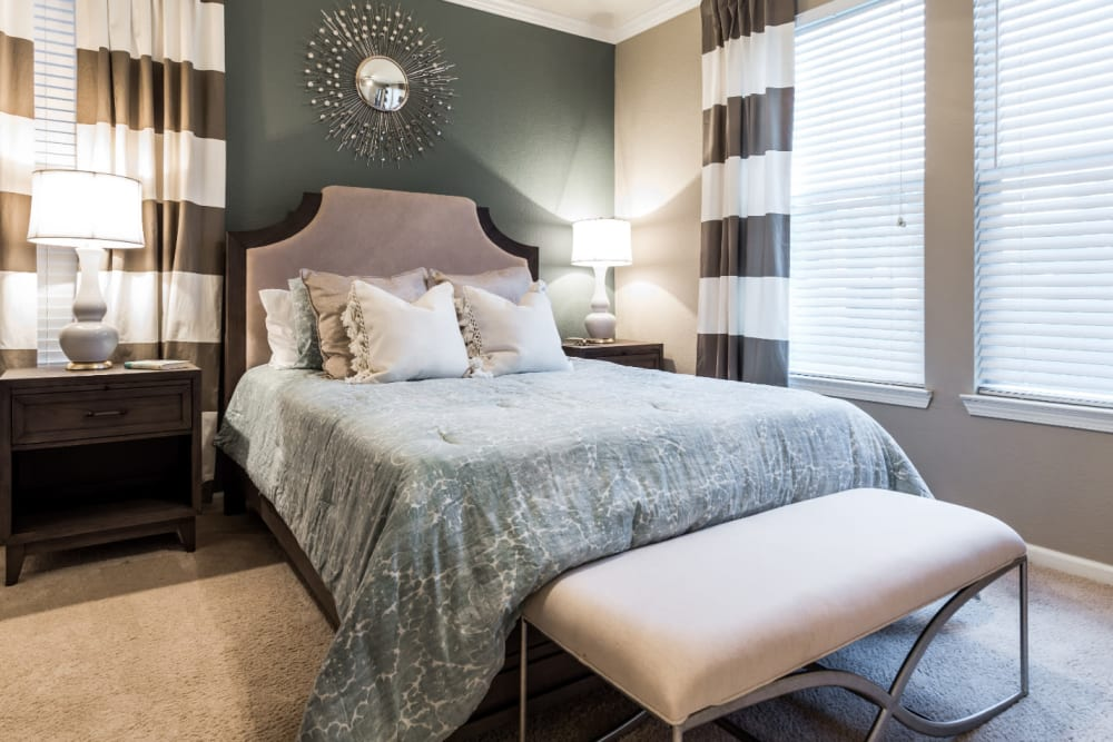 Modern style bedroom with multiple windows at Marquis at The Cascades in Tyler, Texas