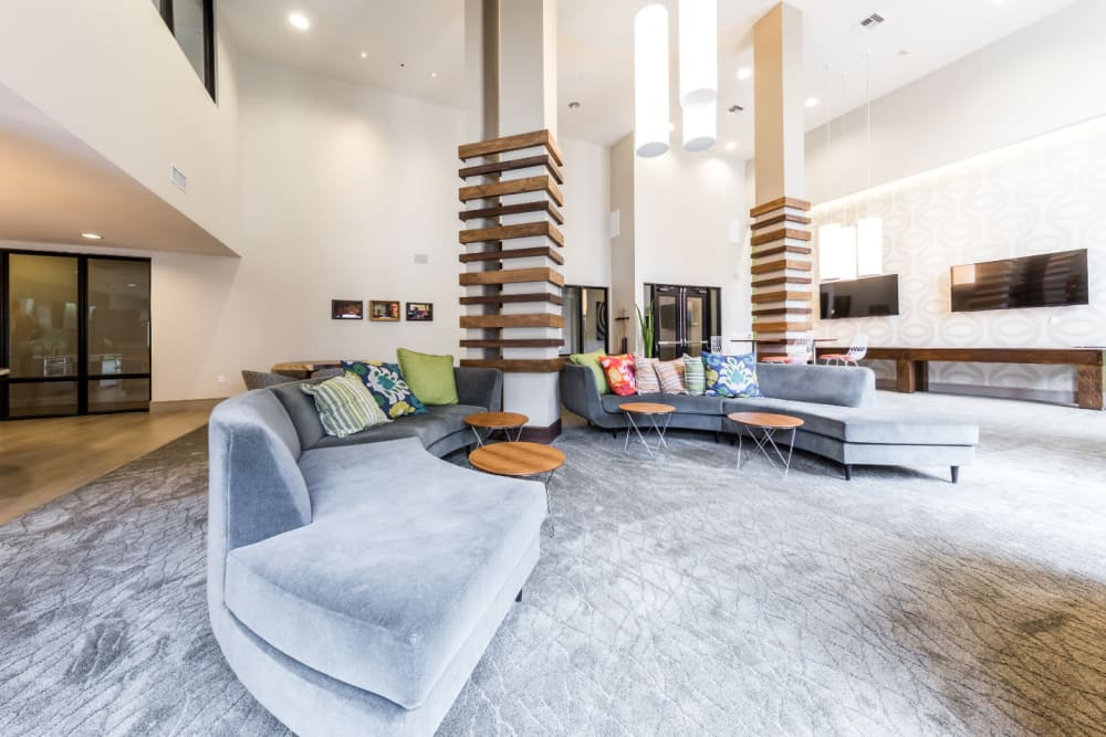 Large sofas with coffee tables in community clubhouse room at Marq Uptown in Austin, Texas