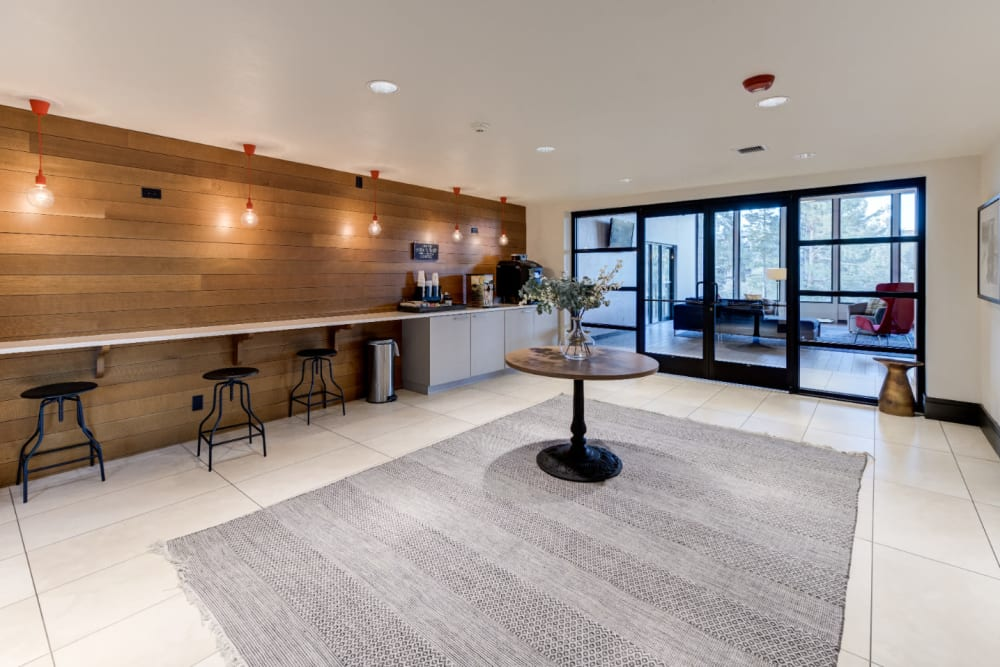 Spacious clubhouse offering coffee refreshments, a dog washing station and more at  Ashford Belmar in Lakewood, Colorado