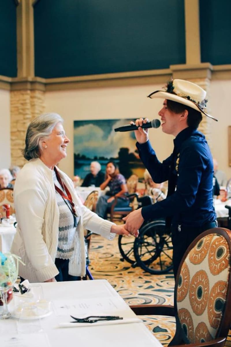A lady being sang to at Landing at Watercrest Shadow Creek Ranch in Pearland, Texas