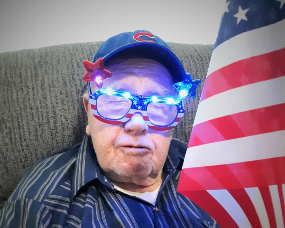A resident wears patriotic sunglasses at Corridor Crossing Place in Cedar Rapids, Iowa.