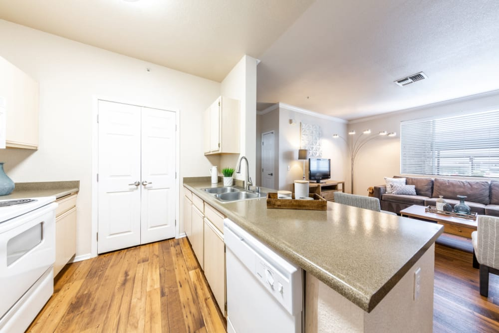 Spacious kitchen with granite counters at The Fairmont at Willow Creek in Folsom, California
