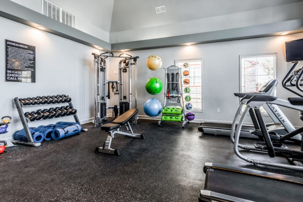 Spacious fitness center with free weights and cardio equipment at The Links at Plum Creek in Castle Rock, Colorado