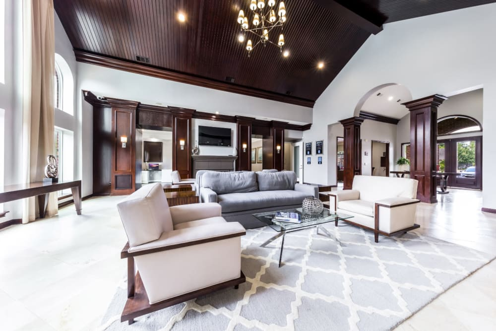 Community clubhouse main sitting area with couches and vaulted ceilings at Marquis on Park Row in Houston, Texas