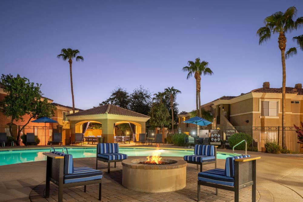 Poolside firepit with chairs at sunset at Alante at the Islands in Chandler, Arizona