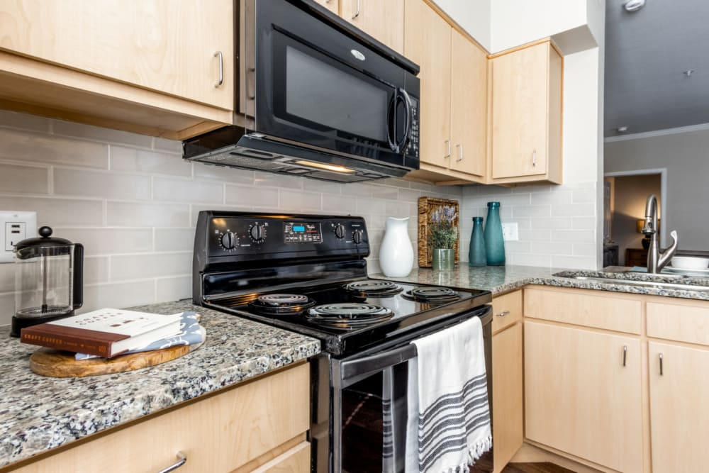 Large kitchen with plenty of cabinet space at The Links at Plum Creek in Castle Rock, Colorado