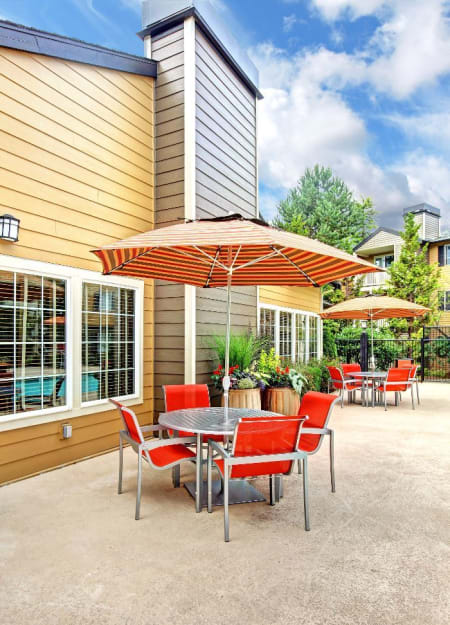 Exterior poolside lounge at Newport Crossing Apartments in Newcastle