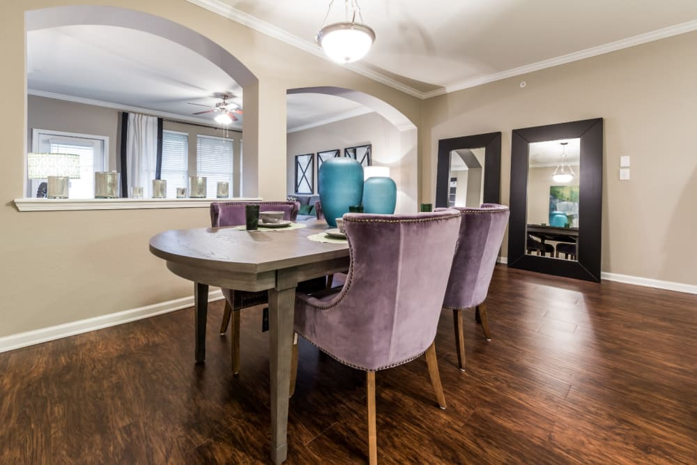 Large dining room with opening to living area at Marquis at The Cascades in Tyler, Texas
