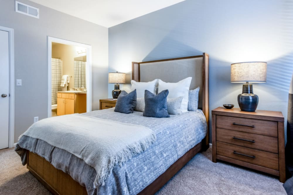 Master bedroom with plush carpeting at The Links at Plum Creek in Castle Rock, Colorado