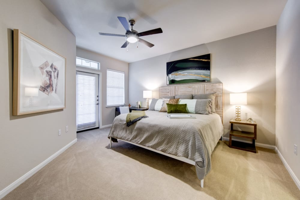 Spacious bedroom with private balcony at Marquis at Cinco Ranch in Katy, Texas