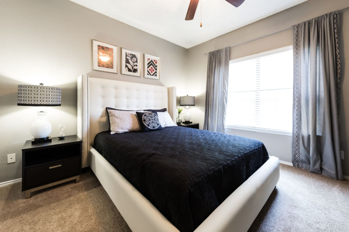 Bedroom with large window at Marquis at Legacy in Plano, Texas