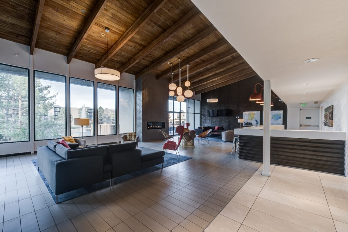 Community clubhouse with lounge area and fireplace at Ashford Belmar in Lakewood, Colorado