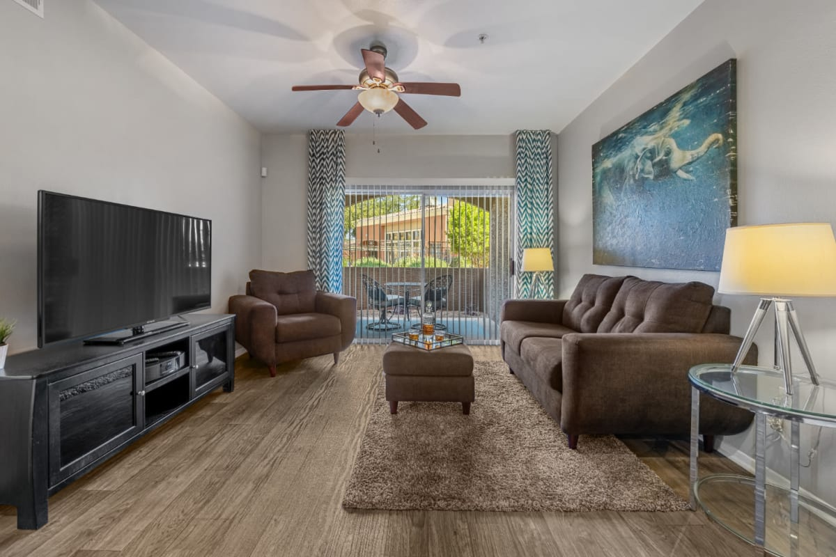 Well decorated living room with private balcony at Alante at the Islands in Chandler, Arizona