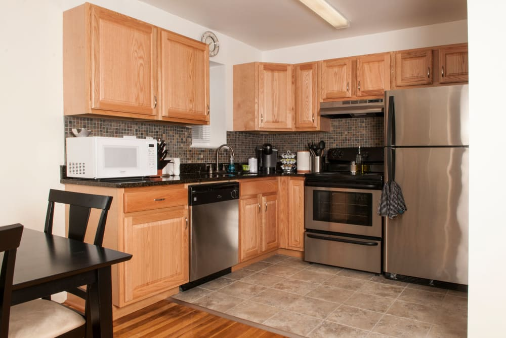 Kitchen with stainless steel appliances at Prospect Ridge Apartments in Hackensack, New Jersey